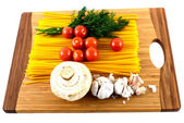 Tomato paste garlic and mushrooms on a cutting board — Stock Photo
