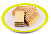Wafer sticks in plate on white background — Stock Photo