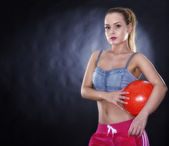 Woman with soccer ball isolated on black background — Stock Photo
