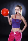 Female football supporter with whistle and football ball, studio — Stock Photo