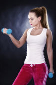 Studio portrait of a beautiful sporty muscular woman working out — Stockfoto