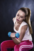 Studio portrait of a beautiful sporty muscular woman working out — Stock Photo