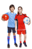 Couple of girl and boy dressed in soccer equipment — Stock Photo