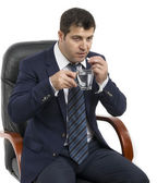 Businessman taking his medication — Stock Photo
