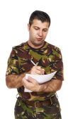 Soldier who writes something on paper — Foto Stock