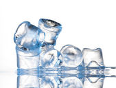 Several ice cubes on glass table — Stock Photo