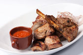 Grilled meat with red sauce — Stock Photo