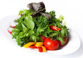 Vegetables on a white plate — Stock Photo