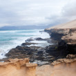 Eroded west coast of Fuerteventura at Jandia, Parque natural de Jandia - Stock Photo