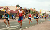 CORRALEJO - April 07: Participant at the running part of the rac — Stockfoto