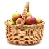 Wicker basket full of apples — Stock Photo