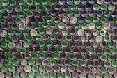 The wall of beer bottles — Stock Photo