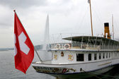 Swiss pleasure boat on the docks of Lake Geneva — Stock Photo
