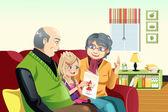 Grandparents and grandaughter reading — Stock Vector