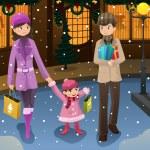 Семья делать рождественские покупки — Cтоковый вектор
