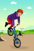 Boy doing a bike stunt — Stock Vector