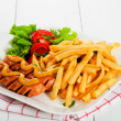 Stock Photo: Potatoes fries and sausage