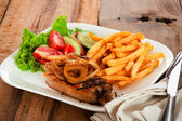 Meat and fried potatoes — Stock Photo
