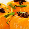 Mandarins in spiced syrup — Stock Photo