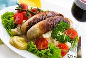 Sausage and salad — Stock Photo