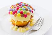 Cupcake and smarties — Stock Photo