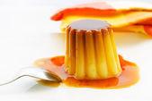 Caramel pudding with fruit — Stock Photo