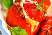 Three stuffed tomatoes on a white plate — Stock Photo