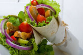 Chicken tortillas with fresh salad ingredients — Stock Photo