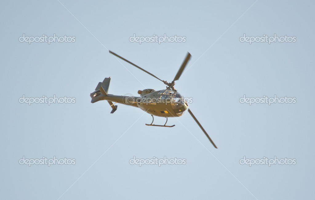 Military helicopter in flight — Stock Photo #12582255