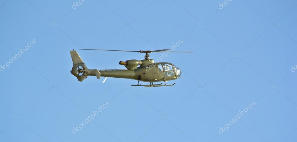 Military helicopter in flight — Stock Photo #12582319