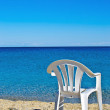 Plastic beach chair on shore near sea — Stock Photo