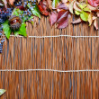 Autumn leaves over wooden background — Stock Photo #13898789