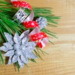 Christmas fir tree with decoration on a wooden board — Stock Photo #14093851