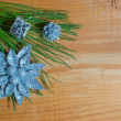 Royalty-Free Stock Photo: Christmas fir tree with decoration on a wooden board