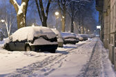 Snow covered cars in the street — Stock Photo
