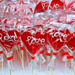 Stock Photo: Red heart shaped lollipop on market stand