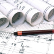 Architect rolls and plans blueprints planning interiors design construction real estate — Stock Photo