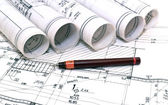 Architect rolls and plans blueprints planning interiors design construction real estate — Foto de Stock