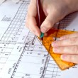 Architect drawing rolls and plans blueprints project - Stock Photo