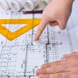 Architect rolls and plans blueprints planning interiors design construction real estate - Stock Photo