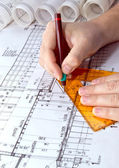 Architect drawing rolls and plans blueprints project — Foto de Stock