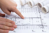 Architect drawing rolls and plans blueprints project — Stock Photo