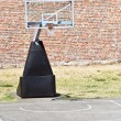Royalty-Free Stock Photo: Basketball hoop and an empty outdoor court