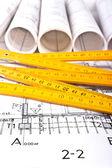 Architect blueprints and rolls background — Stock Photo