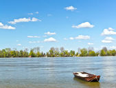 Old fishing boat on river spring blue sunny day scenery Danube Serbia Zemun Gardos Kej — Stock Photo