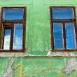 Old dirty window on old dirty wall - Stock Photo