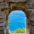 Stock Photo: View cliff and sethrew old stone window