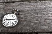 Vintage pocket watch on old wood — Stock Photo