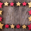Christmas stars frame border on wood — Stock Photo