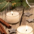 Christmas candles over a old wood background — Stock Photo
